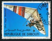 Motorized Hang Gliders. DJIBOUTI - CIRCA 1984: stamp printed by Djibouti, shows Motorized Hang Gliders, circa 1984 stock image