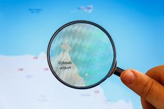 Djibouti, Djibouti. Political map. City visualization illustrative concept on display screen through magnifying glass in the hand royalty free stock image