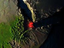 Djibouti en rouge de l'espace la nuit Photos stock