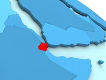 Djibouti en rouge sur le globe bleu Photos stock