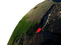 Djibouti en rouge sur terre la nuit Images stock