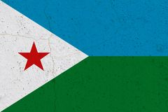 Djibouti flag on concrete wall. Patriotic grunge background. National flag of Djibouti stock photo