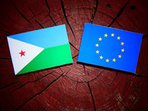 Djibouti flag with EU flag on a tree stump isolated. Djibouti flag with EU flag on a tree stump Stock Image