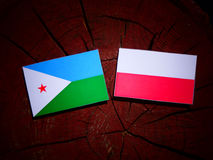 Djibouti flag with Polish flag on a tree stump isolated. Djibouti flag with Polish flag on a tree stump stock illustration