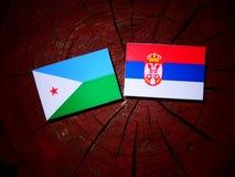 Djibouti flag with Serbian flag on a tree stump isolated. Djibouti flag with Serbian flag on a tree stump royalty free stock photo