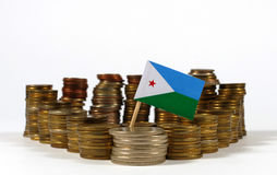 Djibouti flag with stack of money coins Royalty Free Stock Images