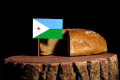 Djibouti flag on a stump with bread Stock Photo