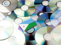 Djibouti flag on top of CD and DVD pile isolated on white. Djibouti flag on top of CD and DVD pile isolated Stock Images