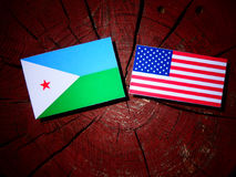 Djibouti flag with USA flag on a tree stump  Royalty Free Stock Images