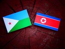 Djibouti flaga z koreańczyk z korei północnej flaga na drzewnym fiszorku Zdjęcia Stock