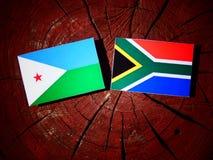 Djibouti flaga z południe - afrykanin flaga na drzewnym fiszorku odizolowywającym Zdjęcie Stock