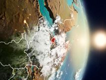Djibouti during sunrise. Highlighted in red on planet Earth with visible country borders. 3D illustration. Elements of this image furnished by NASA Royalty Free Stock Photos