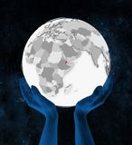 Djibouti sur le globe blanc dans des mains illustration stock