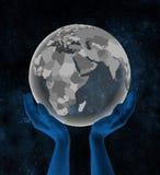 Djibouti sur le globe dans des mains dans l'espace illustration de vecteur