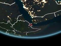 Djibouti sur terre de l'espace la nuit illustration de vecteur