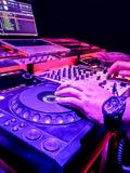 DJs are turntablism turntables plate mixer night party pub Motion blur wite light sunset abstract. Background stock photo