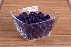 Djupfryst blåbär i en glass bunke Royaltyfri Fotografi