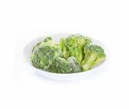 Djupfryst broccoli på vit Royaltyfria Foton