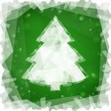 Djupfryst julgran på en grön fyrkantig bakgrund Arkivbild