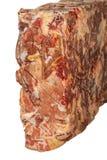 Djupfryst kvarter av nötkött på en vit bakgrund arkivfoton