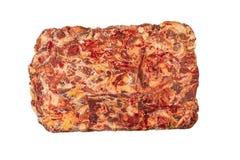 Djupfryst kvarter av nötkött på en vit bakgrund royaltyfri foto