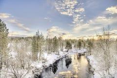 Djupfryst Lake i Inari, Finland Royaltyfri Foto