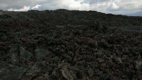 Djupfryst lavaflöde resultera från utbrottlägenheten Tolbachik i 2012 arkivfilmer