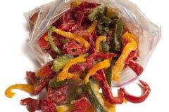 Djupfryst varicoloured söt peppar i packen för att frysa Royaltyfri Foto