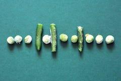 Djupfrysta grönsaker i rad Arkivfoto