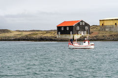 Djupivogur is a small fishing town. The coastal town of Djupivogur in east Iceland has gained `slow city` status Stock Images