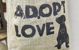 Djur adoption Arkivbild