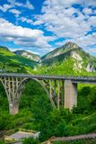 The Djurdjevic Bridge crosses the canyon of the Tara River. In the north of Montenegro Royalty Free Stock Photo