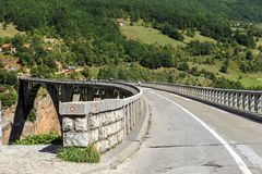 Djurdjevic Bridge, Montenegro. ZABLJAKA, MONTENEGRO - SEPTEMBER 11, 2013: The Djurdjevic Bridge is a concrete arch bridge across the Tara River, which is 116 Royalty Free Stock Photography