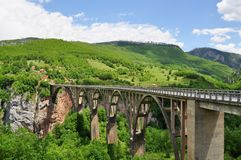 Djurdjevic`s Bridge - a concrete arch bridge across the Tara River in Montenegro stock photography