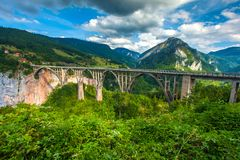 Stone bridge across the deep river canyon. Djurdjevica Tara Bridge. Durmitor National Park. Montenegro Stock Photos