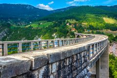 Stone bridge across the deep river canyon. Djurdjevica Tara Bridge. Durmitor National Park. Montenegro Stock Image