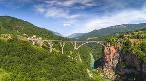 Djurdjevica Tara Bridge in Montenegro. Djurdjevica Tara Bridge is a concrete arch bridge over the Tara River in northern Montenegro. 365m long and the roadway Stock Image
