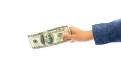 Dólar americano na mão da criança Fotografia de Stock Royalty Free