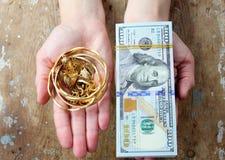 Dólar con oro Foto de archivo