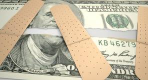 Dólar de EE. UU. rasgado cuidado Imagenes de archivo