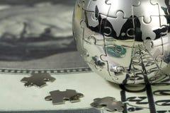 Dólar e globo. Imagem de Stock