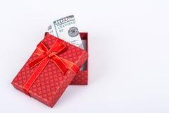 Dólar en caja de regalo Foto de archivo libre de regalías