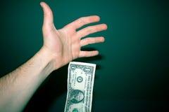 Dólar que cae Fotos de archivo