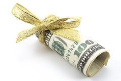 Dólares con la cinta de oro Foto de archivo libre de regalías