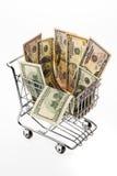 Dólares de los E.E.U.U. del dinero con la cesta de compras Fotos de archivo