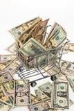 Dólares de los E.E.U.U. del dinero con la cesta de compras Fotografía de archivo libre de regalías