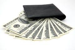 Dólares e bolsa preta Imagens de Stock Royalty Free