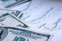 Dólares e estoque Fotografia de Stock Royalty Free