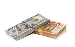 Dólares e euro Imagem de Stock