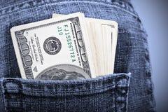 Dólares en bolsillo Imagen de archivo